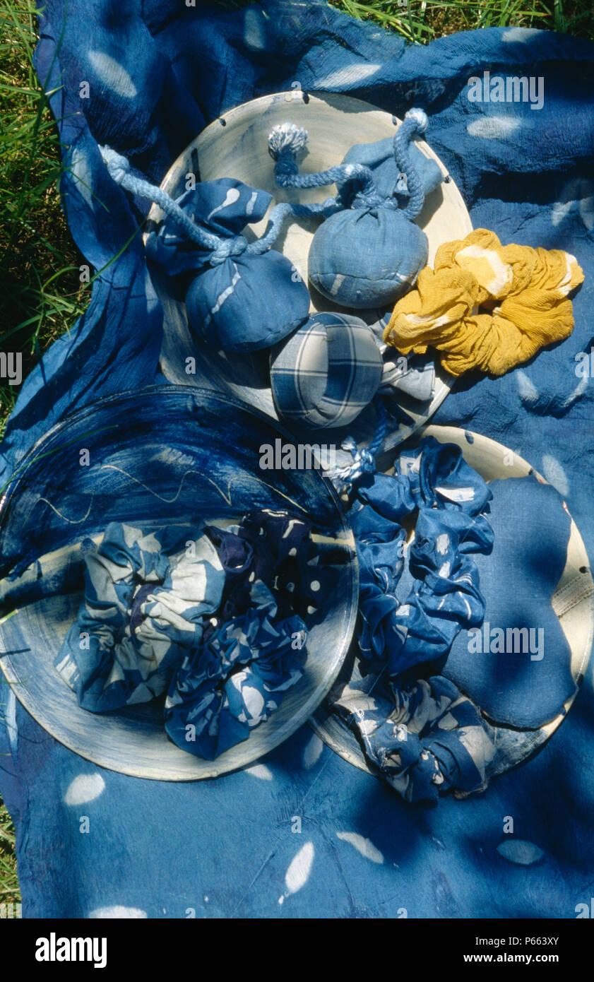 Still-Life of blue indigo dye with dyed cloth Stock Photo