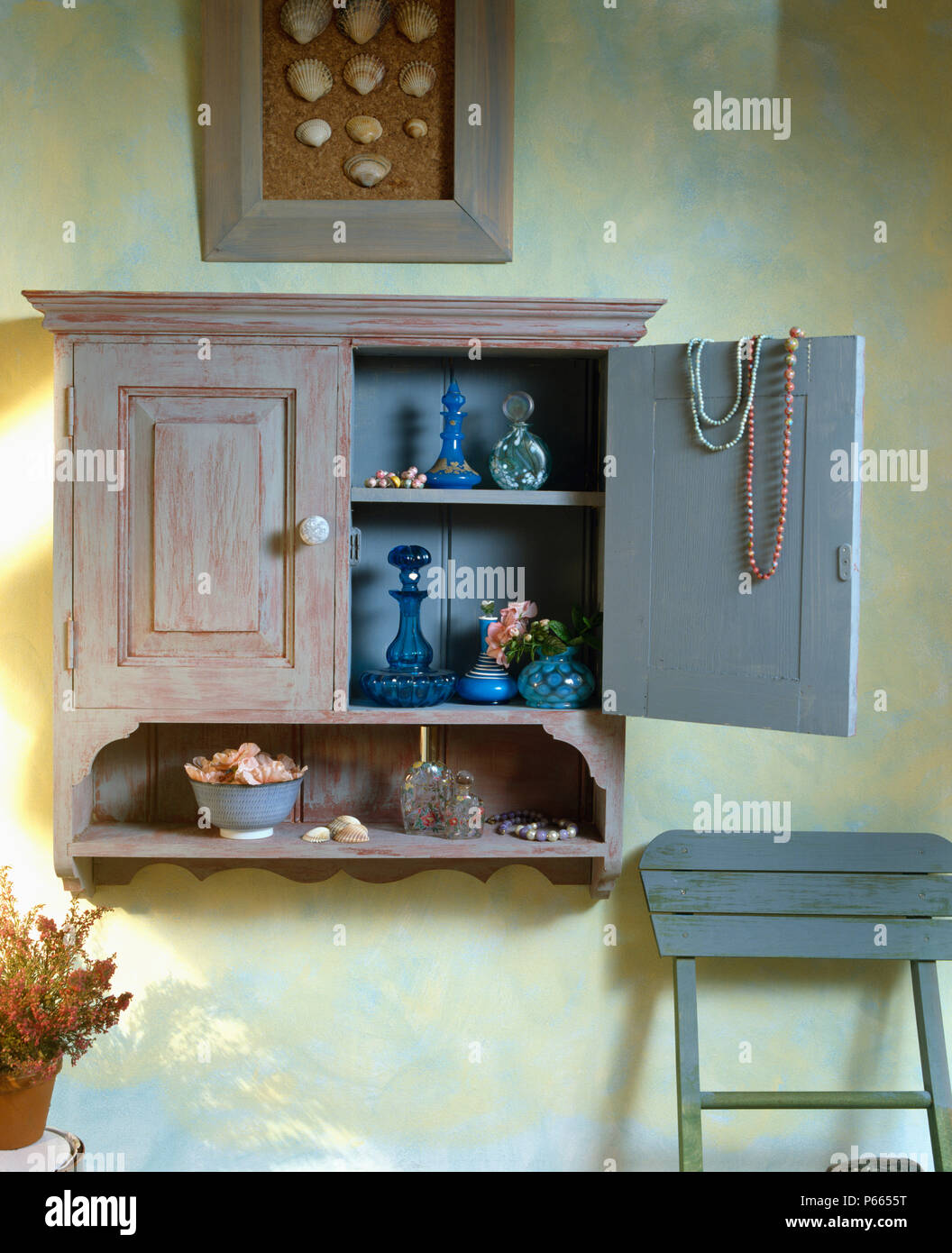 Close Up Of Wall Cupboard With Hand Painted Distressed Paint Effect Stock Photo Alamy
