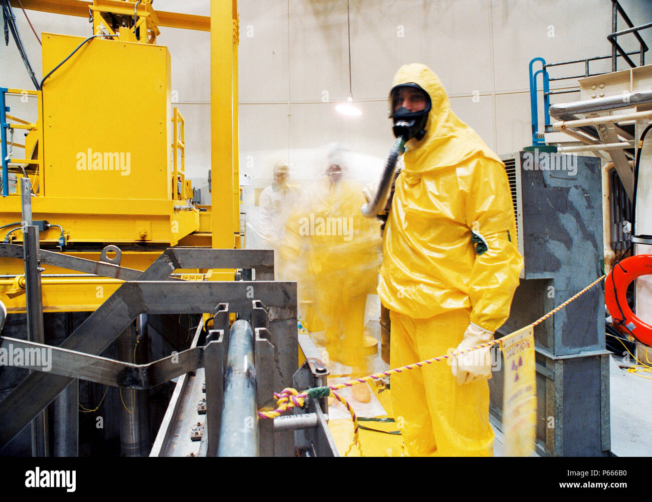 Man in radiation suit in nuclear reactor - Stock Image