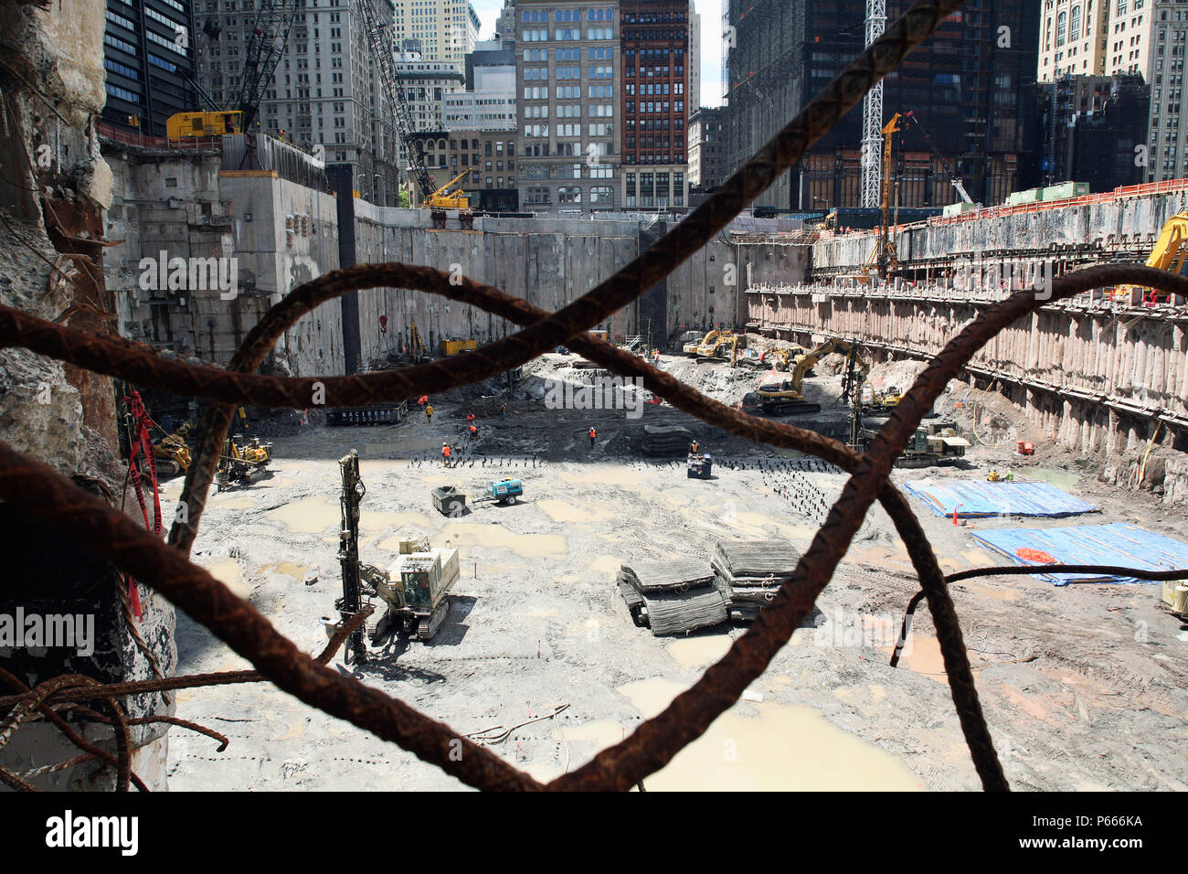 Tower Three and Tower 4 site as seen through twisted rebar at World Trade Center site, Lower Manhattan, New York City, USA - Stock Image