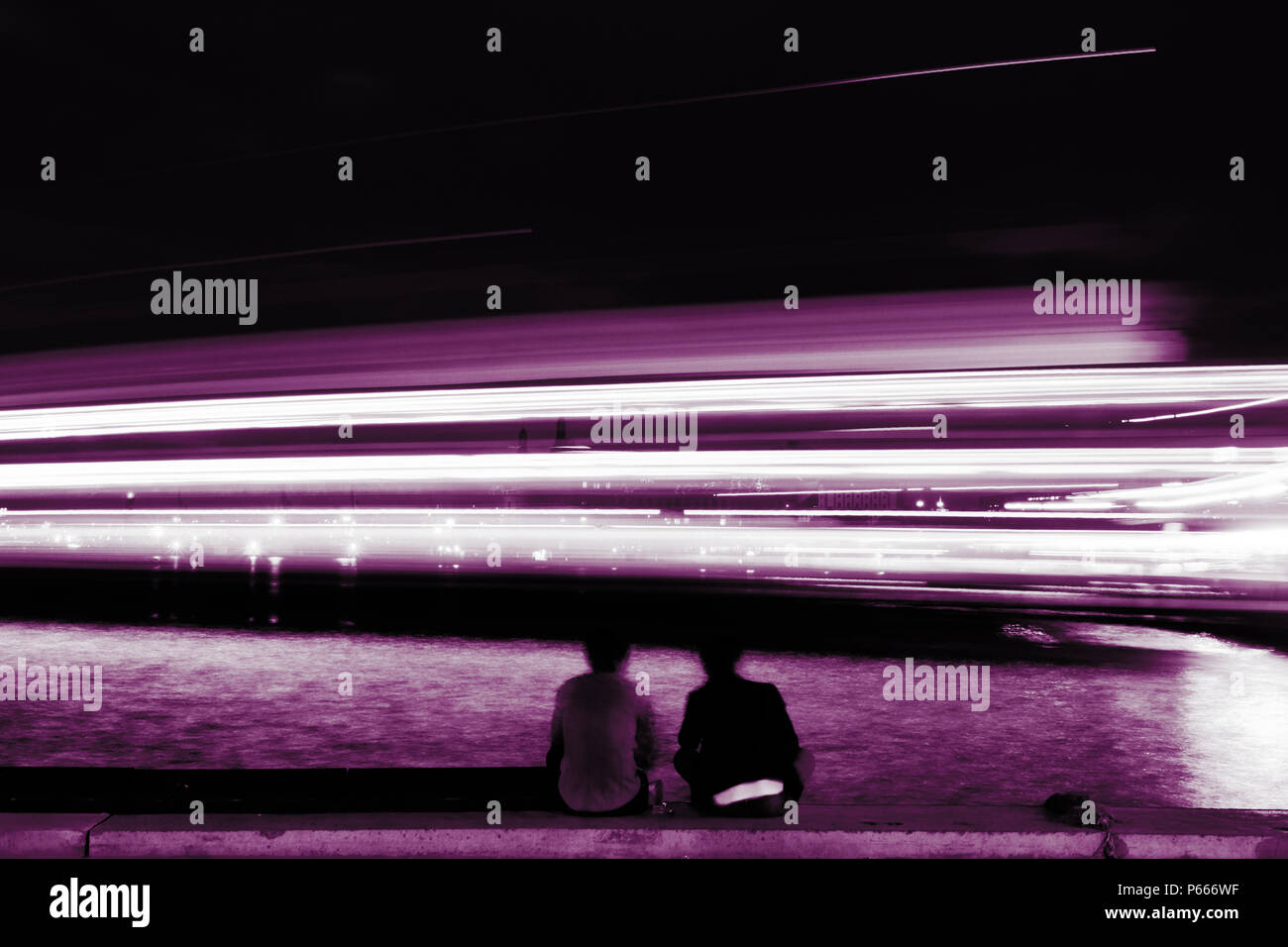 Tail lights of a ship at night with people - Stock Image