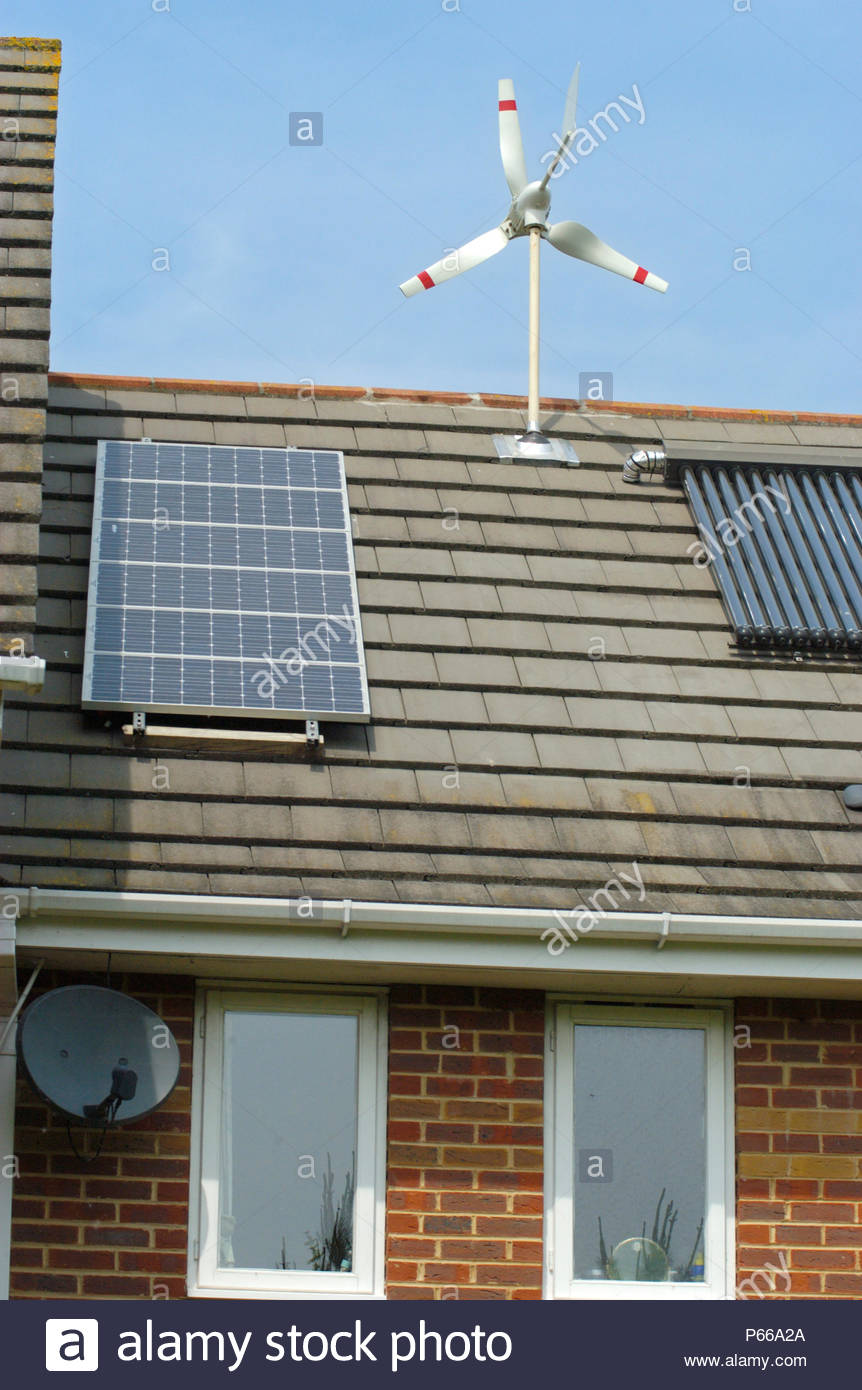 Micro Wind Turbine evacuated tube  & photo voltaics cells on house in Ferndown Dorset England.supplied by Powertech Solar Ltd - Stock Image