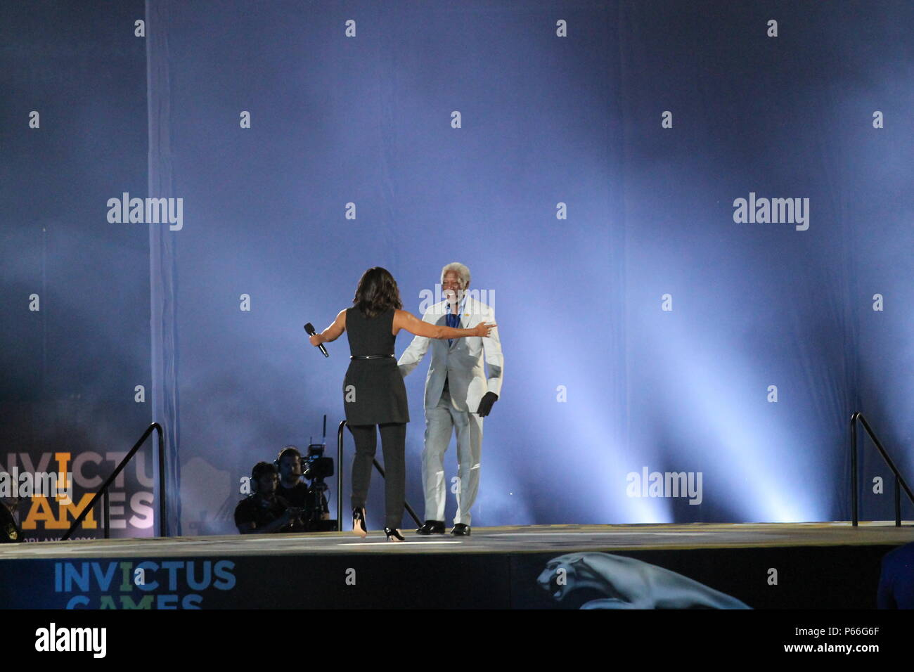 First lady michelle obama and actor morgan freeman exchange first lady michelle obama and actor morgan freeman exchange greetings during the opening ceremony of the 2016 invictus games held at walt disney world m4hsunfo