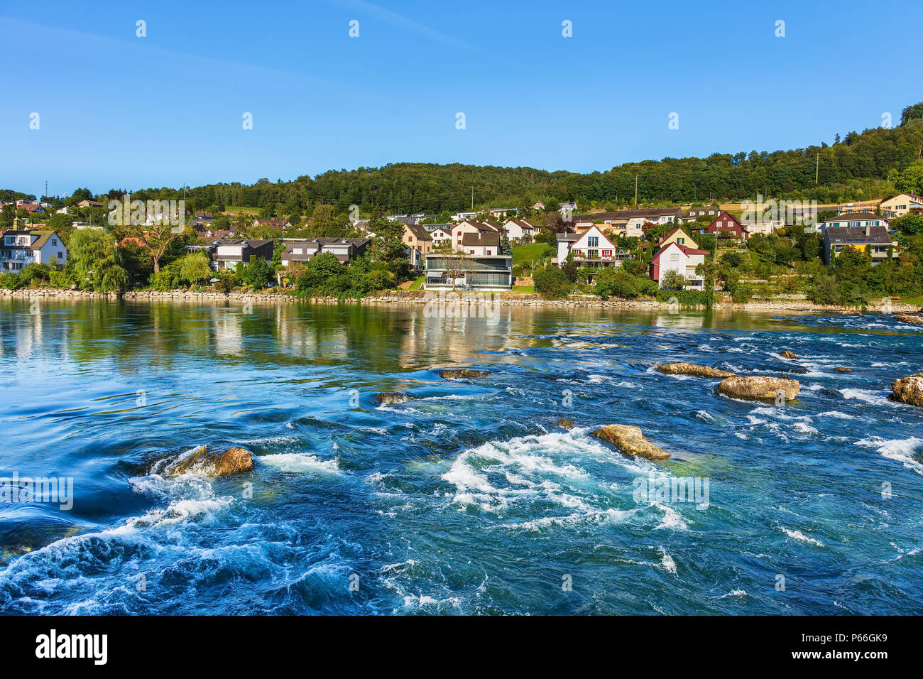 The Rhine river between the city of Schaffhausen and the Rhine Falls in Switzerland in summertime. Stock Photo