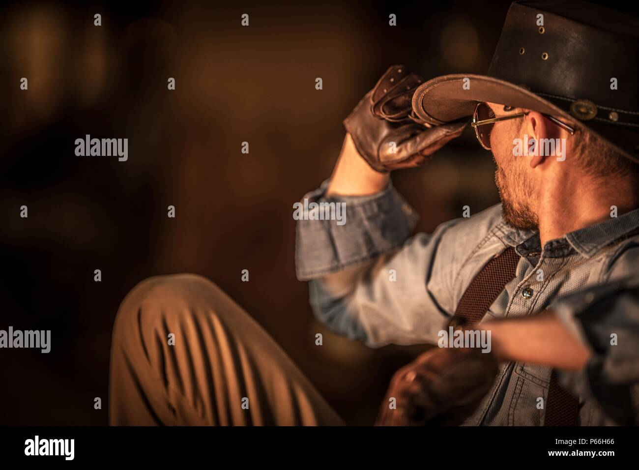 Resting American Cowboy After Hard Ranch Work. Countryside Theme. - Stock Image