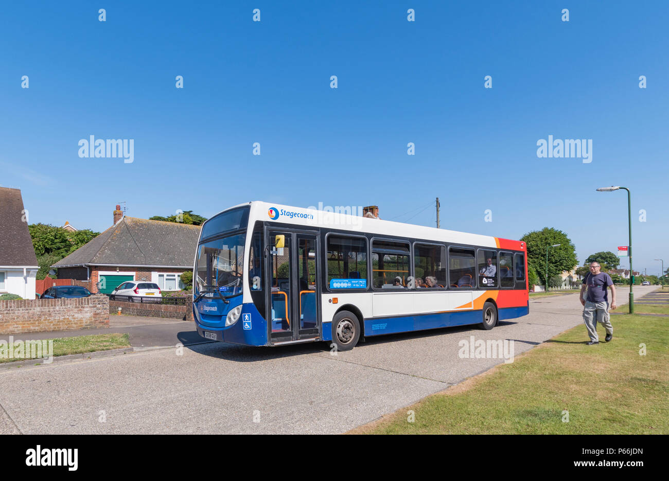 Number 9 Stagecoach single deck bus in a residential area in Rustington, West Sussex, England, UK. Stock Photo