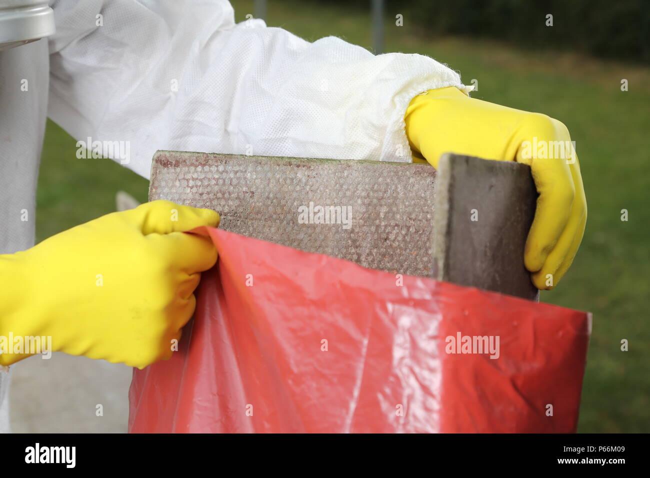 A Disposal of Asbestos Material close up - Stock Image