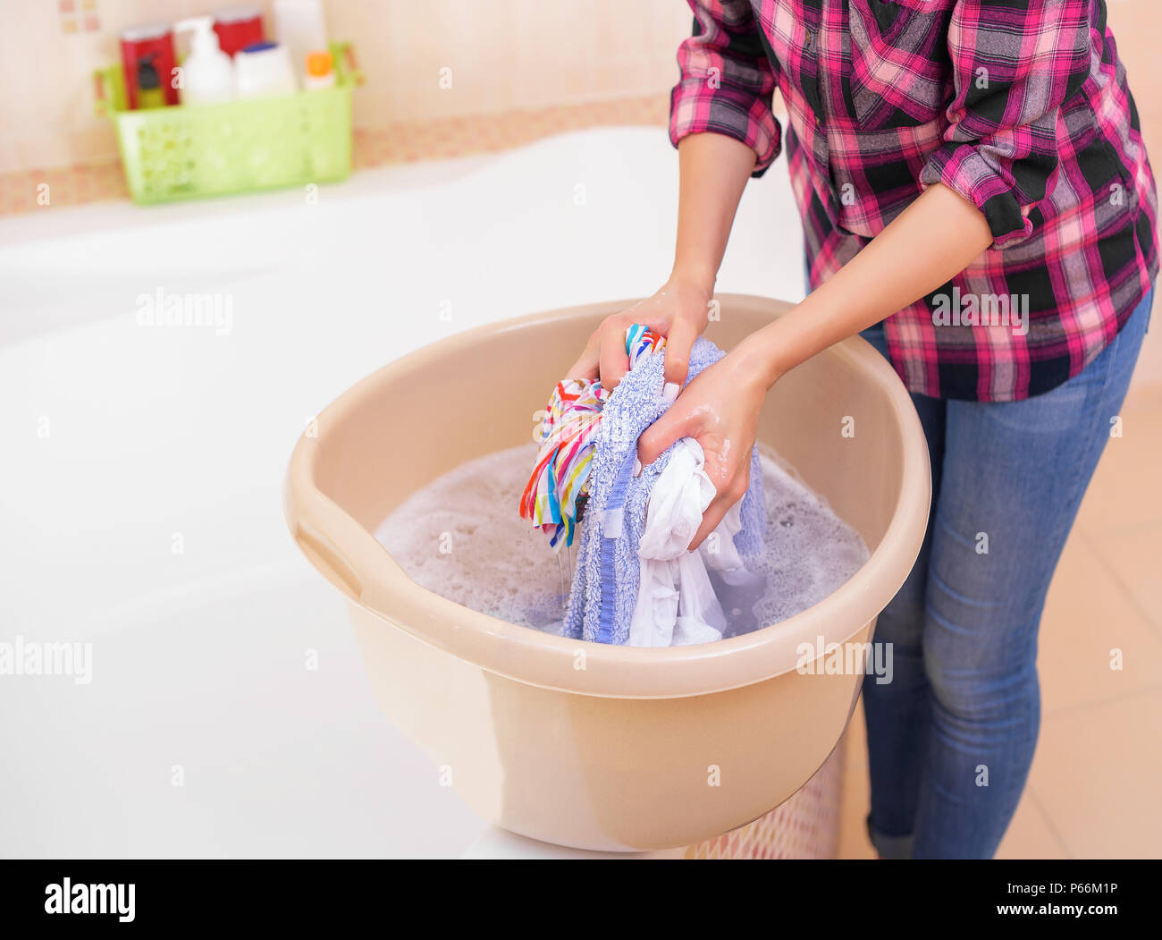 Women's hands wash clothes in the basin Stock Photo - Alamy