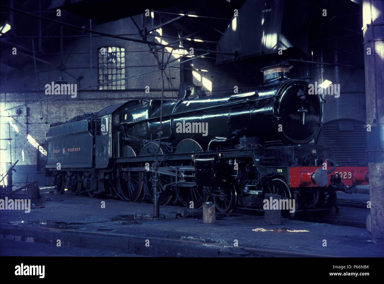 Former Great Westerm Castle Class 4-6-0 No.7029, Clun Castle, minus nameplates, in the roundhouse at Tyseley depot, Birmingham. This locomotive was ac - Stock Image