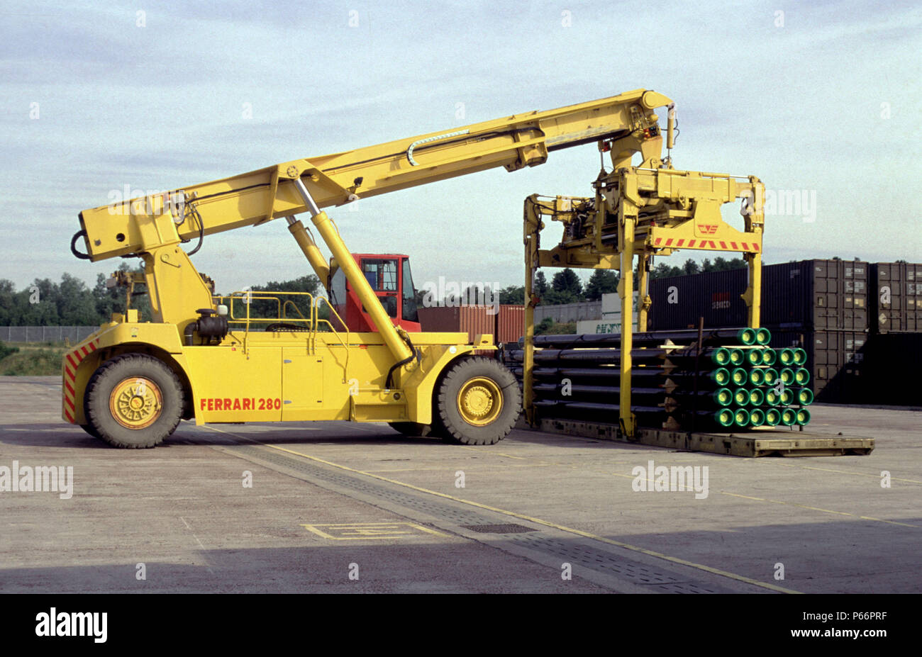 Giant lift trucks are used to load container cargo at the EWS freight terminal at Mossend near Motherwell, Strathclyde. August 2001 Stock Photo
