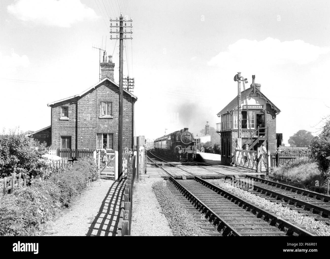 Heckington looking east with a typical GNR signal-box and somersault signal. The train is the 2.39 Skegness to Birmingham on July 27th 1963. It is wor - Stock Image