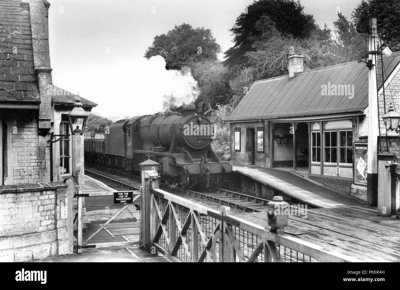 Ketton and Collyweston station in Rutland, England's smallest county. A Stanier 8F steams through with a rake of freight empties. c1960 - Stock Image