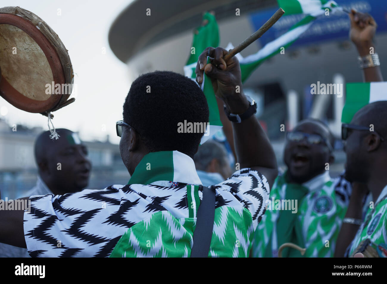 2a4cb5283058 St. Petersburg, Russia - June 26, 2018: Nigerian football fans with  tambourine