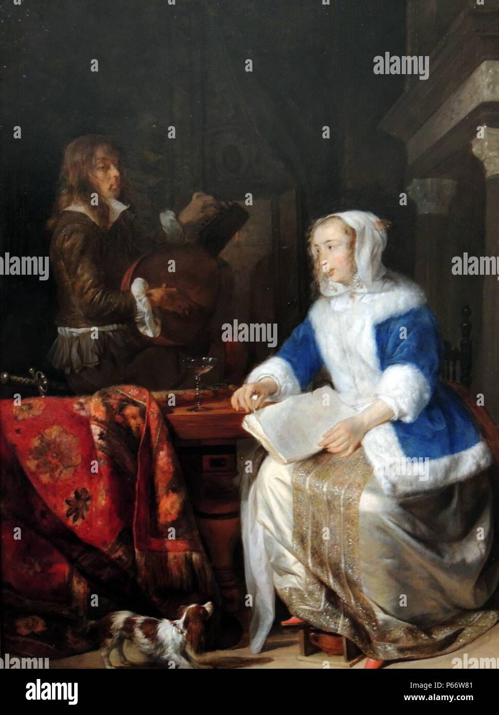 The Duet ('Le corset bleu') by Gabriel Metsu (1629 – 1669) Dated 1660 - 1667. Oil on panel. The painting symbolises amorous activity between the woman and the cavalier. Part of the art collection at Upton House in the English county of Warwickshire. Stock Photo