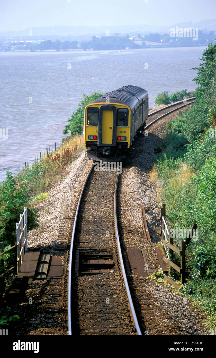 A Wessex Trains Class 153, on the branch line from Exeter to Exmouth, runs next to the estuary of the River Exe at Lympstone with a service from Exmou - Stock Image