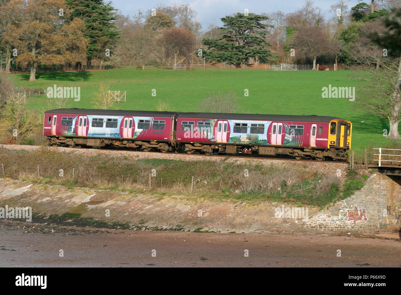 A Wessex Trains DMU skirts the Devon coast at Lympstone with a local branch line service from Exeter St David's to Exmouth, November 2004 - Stock Image