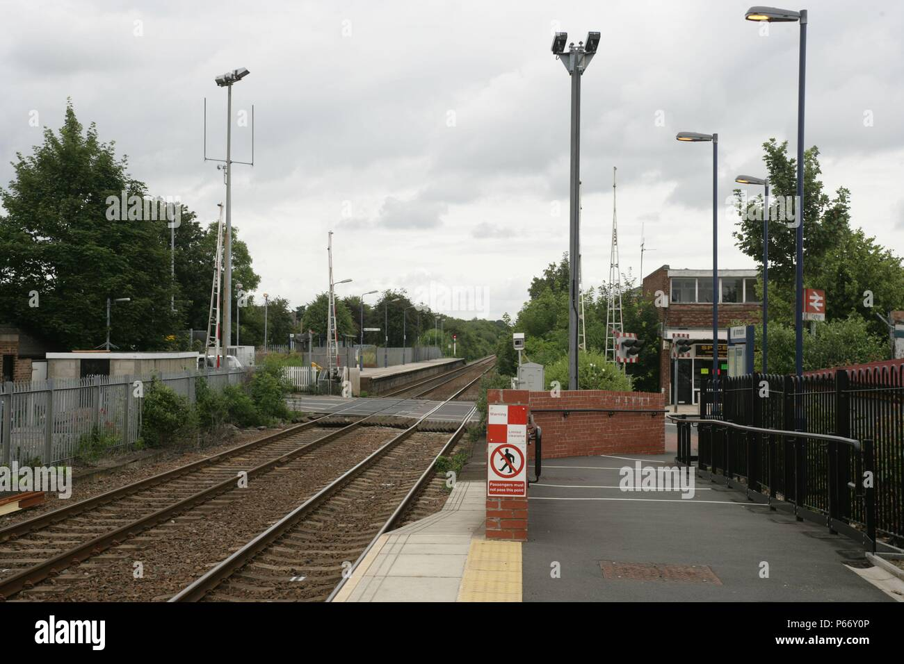 Entrance ramp, level crossing and CCTV cameras at Carlton station, Nottinghamshire. 2007 - Stock Image