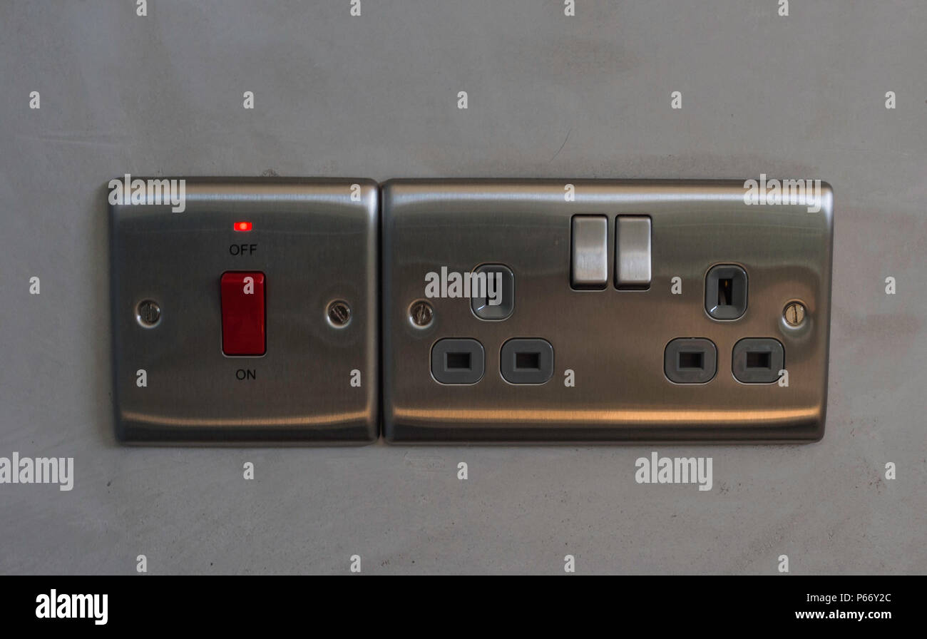One fused 32 amp socket with light and a standard double electrical socket in gun metal grey - Stock Image