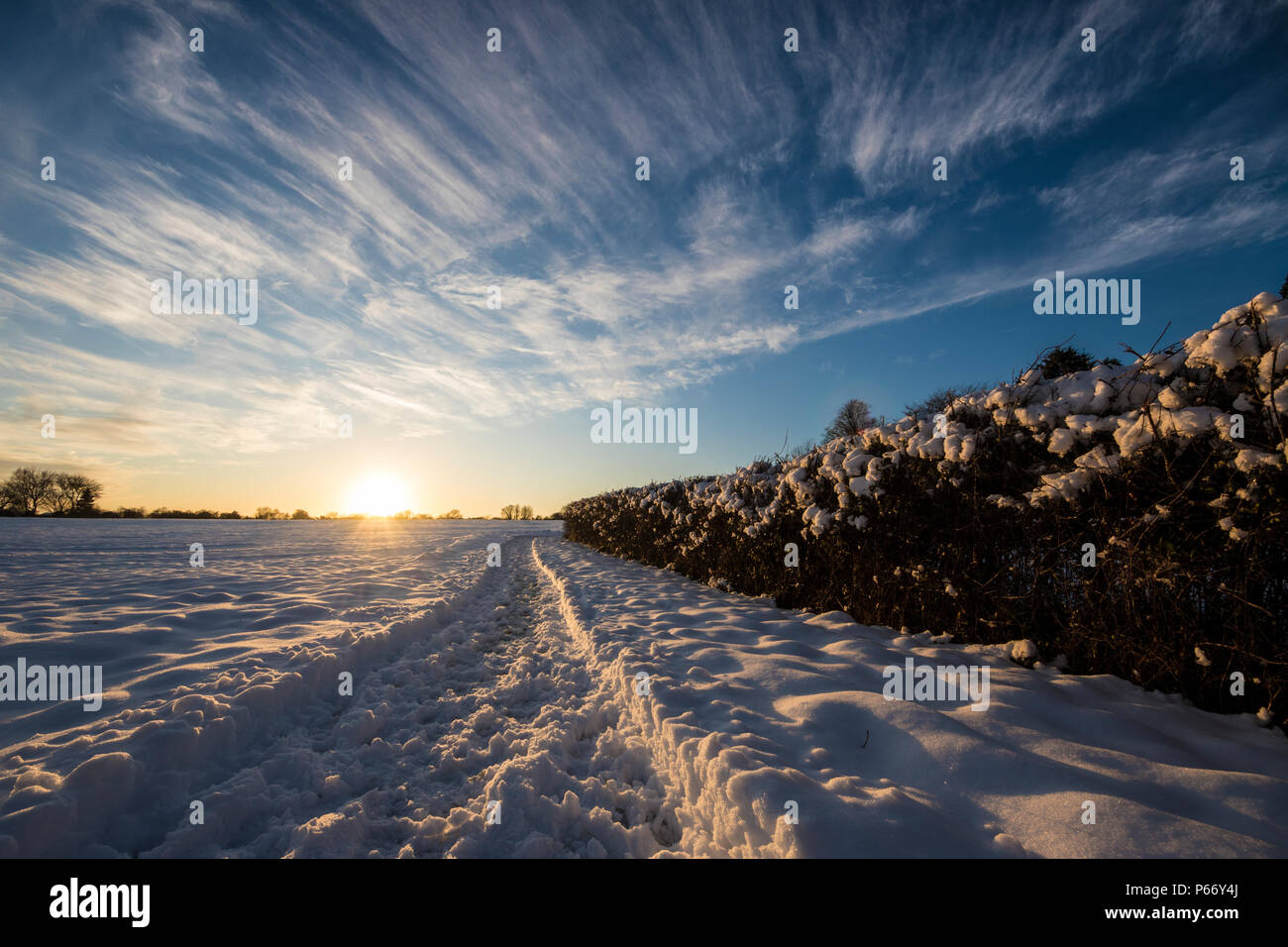 Snow day sunset - Stock Image