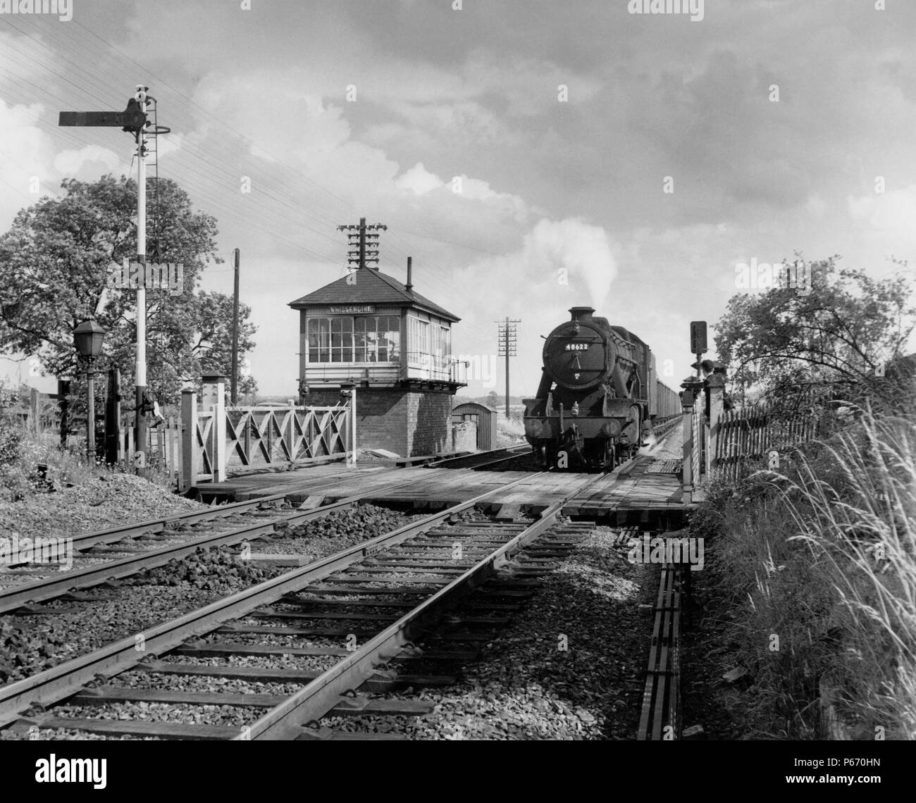 The location is Whissendine, between Melton Mowbray and Oakham on the Leicester to Peterborough line. The signalman in the MR box watches the photogra Stock Photo