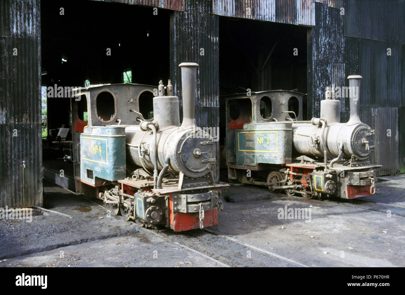 The loco Shed at Nsuta Manganese Ghana with a brace of Orenstein & Koppel 2'6'' gauge 0-6-0 Well Tanks, Left is No.4 O&K No.10610 1923 right No.3 O&K  - Stock Image