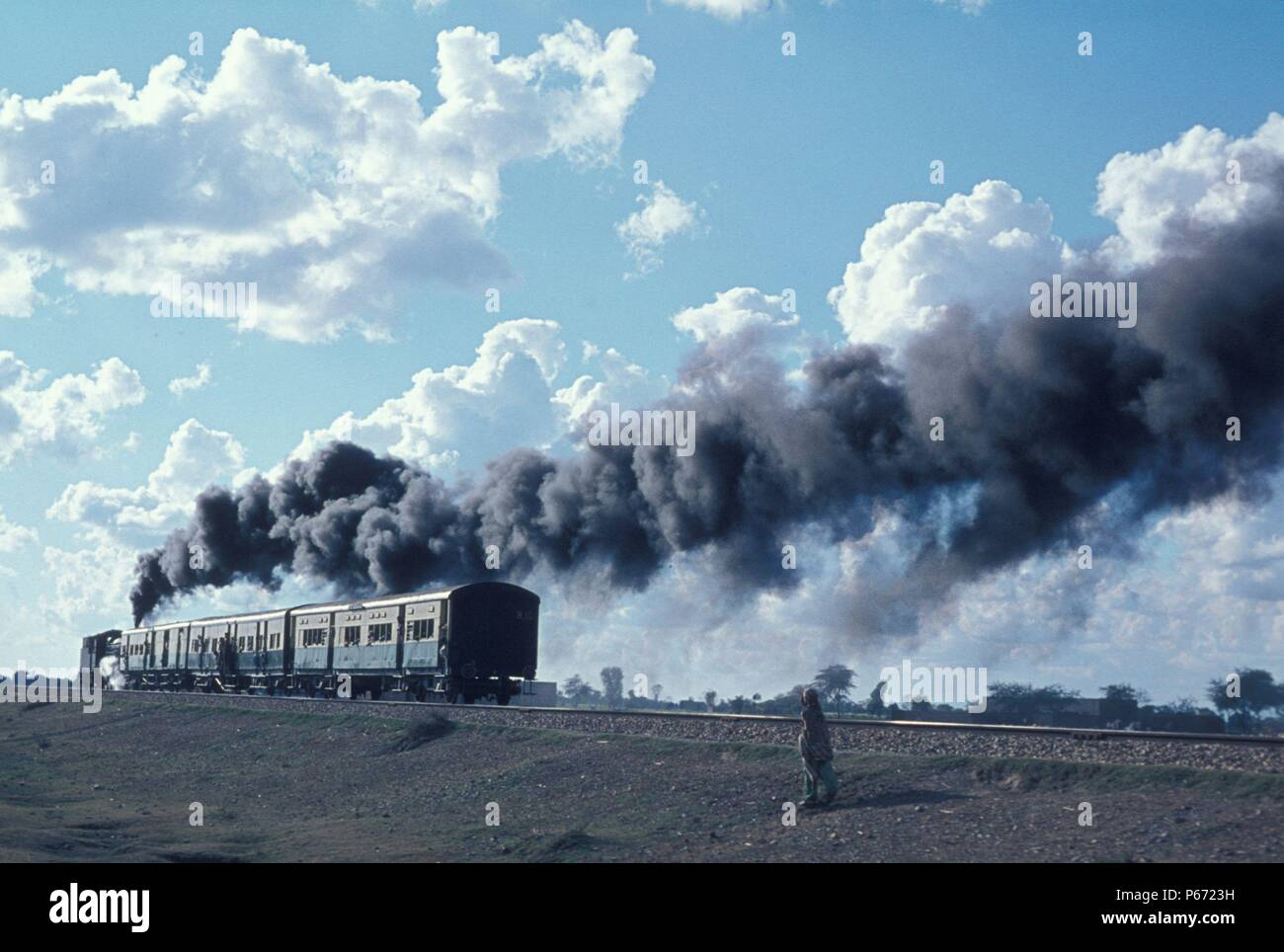 A passenger train heads away from Malakwal Junction on the Pakistan Punjab. January 1977. - Stock Image