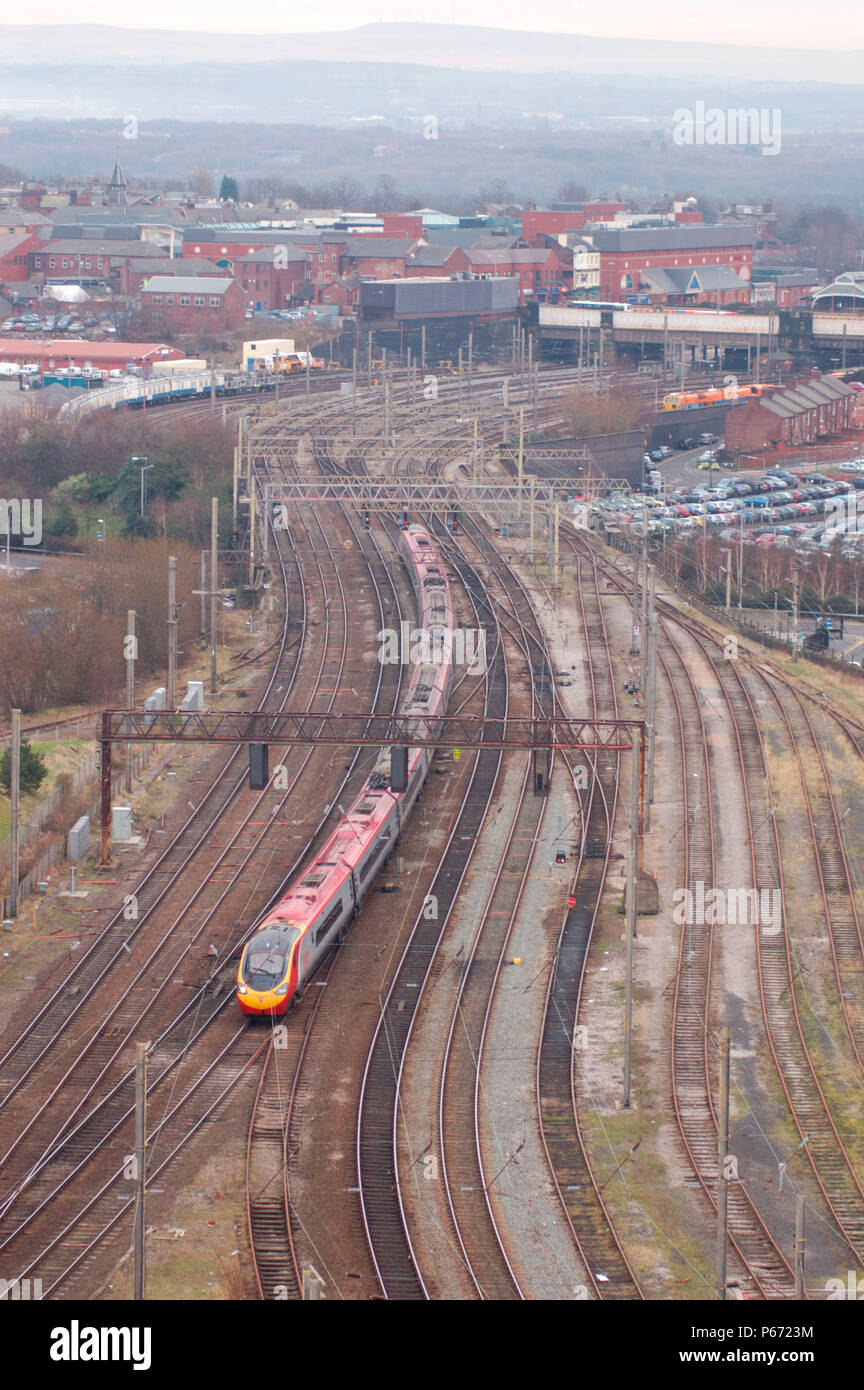 A Pendolino trainset curves out of Preston with a Euston - Glasgow Central service. February 2005. - Stock Image