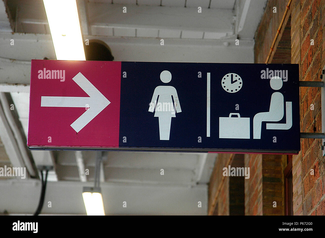 A station sign indicates waiting room and Ladies Toilet on c2c - Stock Image