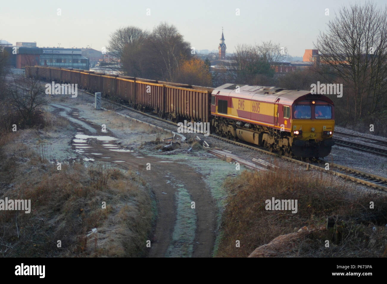 An EWS freight train is seen here as it heads towards Leicester station on the midland mainline on a cold frosty morning. 2004. - Stock Image