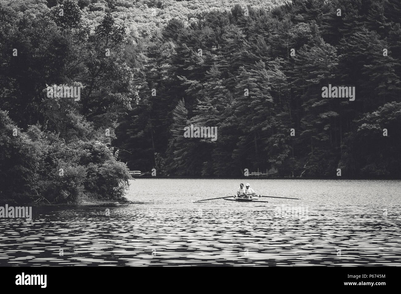 Two rowers in a pair on Lake Luzerne, New York Stock Photo