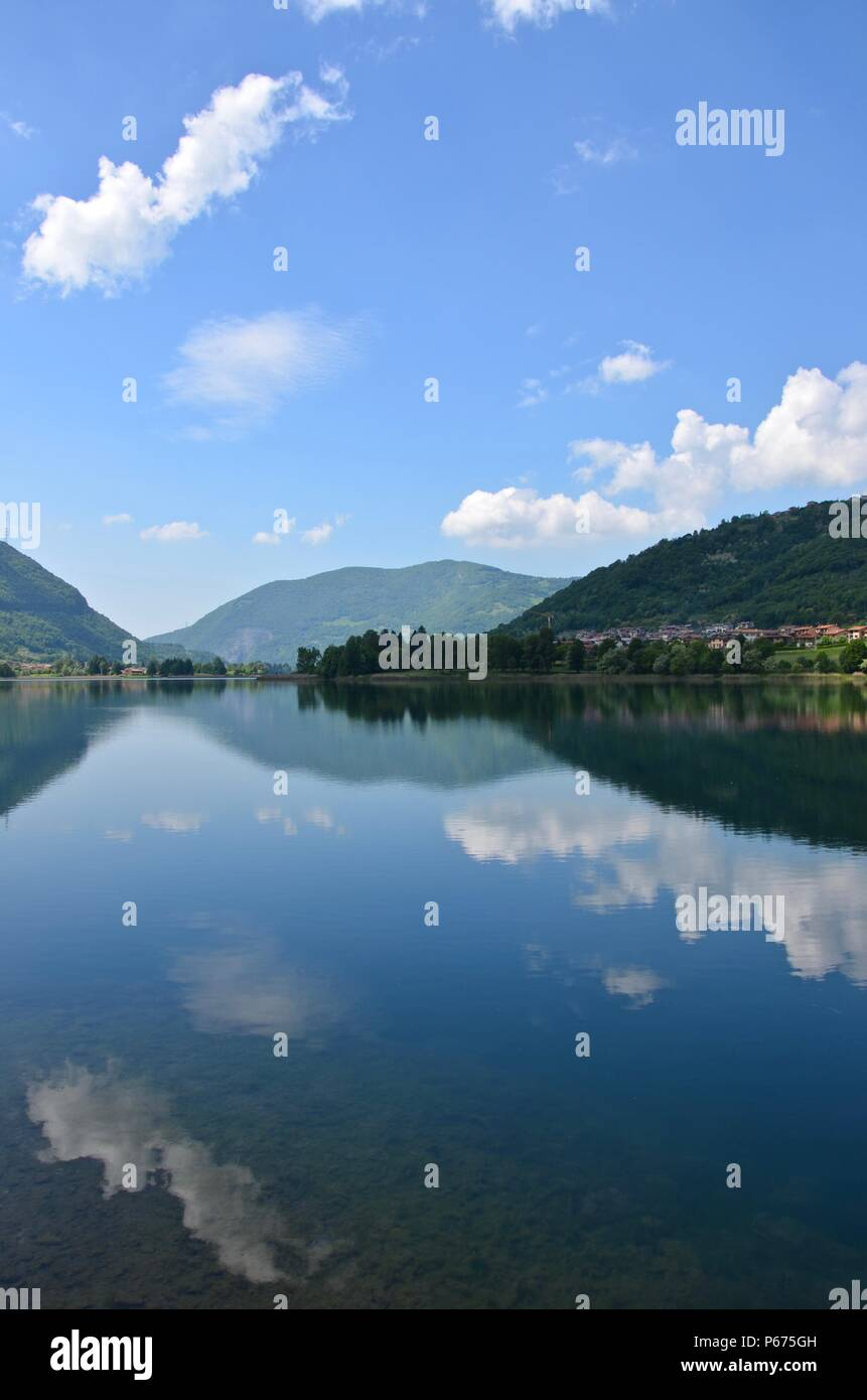 Lago d'Iseo in Lombardy in Italy, Bergamo, blue sky, summer, season, water sports, vacation, boat rides, climbing, mountains, lake, hiking trails - Stock Image