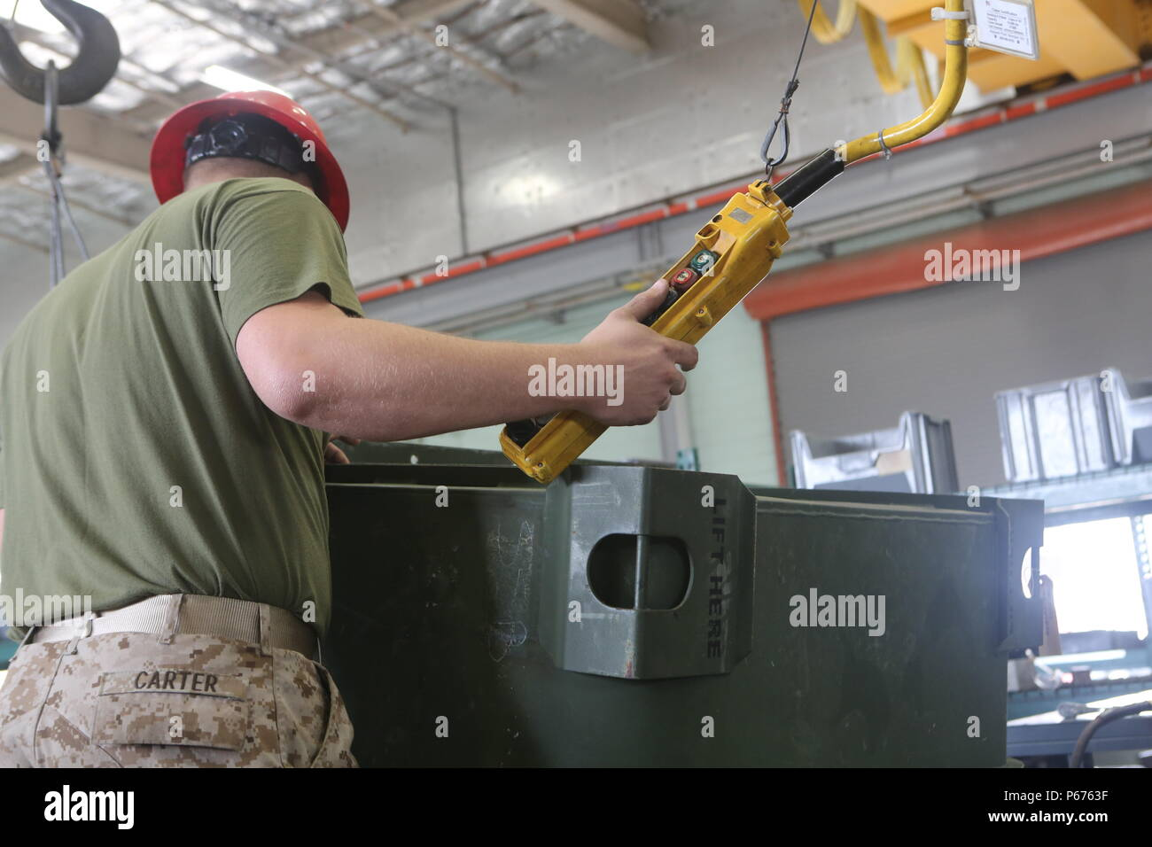 U.S. Marine Corps Lance Cpl. Tyler Carter, Combat Logistics Regiment (CLR) 15, Repairable Maintenance Company works to repair a 6.5L Turbo Diesel Engine during a MLG Day event on Camp Pendleton, Calif., May 18, 2016. The purpose of MLG Day is to showcase the capabilities of the 1st MLG to new officers and international military visitors.(U.S. Marine Corps photo by Lance Cpl. Salmineo Sherman Jr. Combat Camera 1st MLG/ RELEASED) - Stock Image