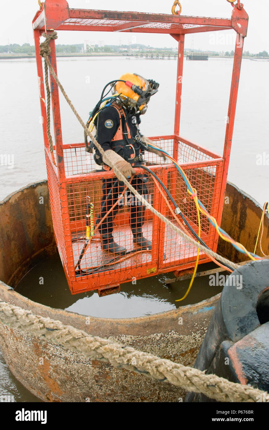 The 2 temp piers had to be cut at river bed level by Divers, this was a tuff job as visibility was poor and the confined space. - Stock Image