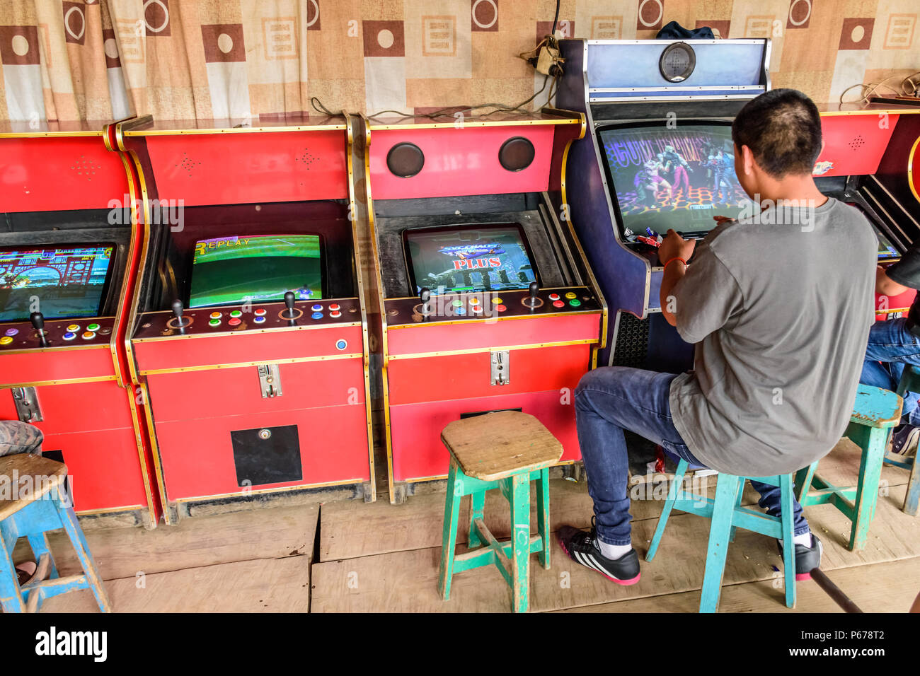 San Juan del Obispo, Guatemala - June 24, 2018: Local plays arcade games at village fair near UNESCO World Heritage Site of Antigua - Stock Image