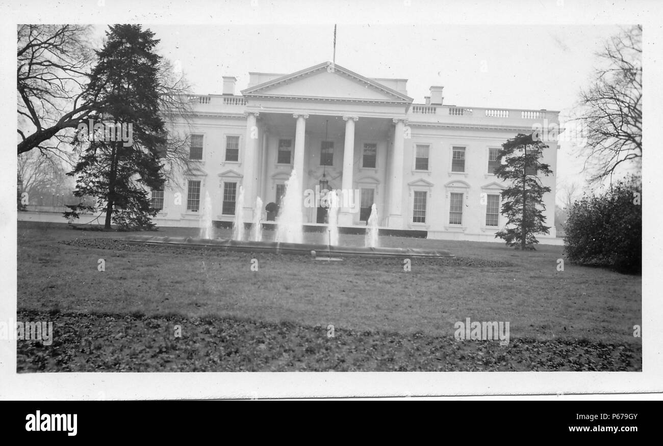Black and white photograph, shot at a slight angle, showing an external view of a stately, neoclassical building, with a fountain, open lawn, and several trees visible in the foreground, likely photographed in Ohio in the decade following World War II, 1950. () - Stock Image