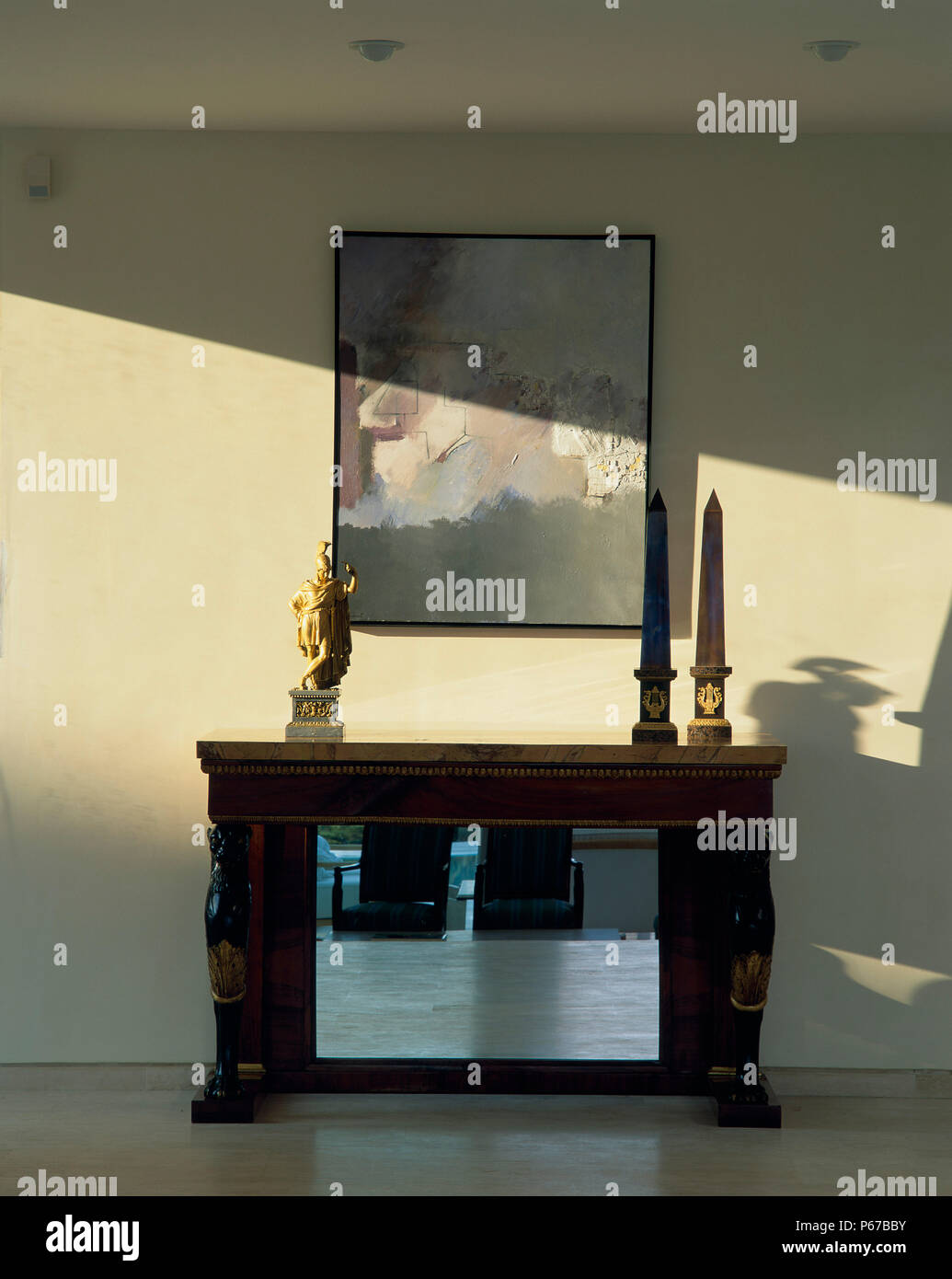 View of a mantle adorned with ornaments - Stock Image