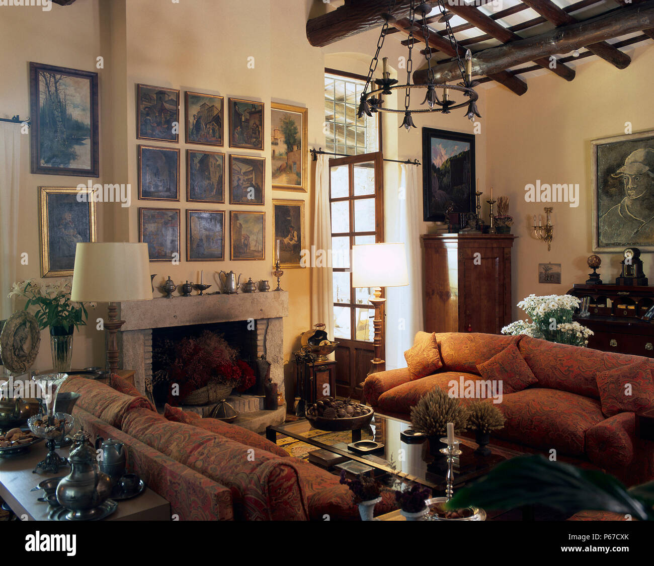 View Of An Organized Living Room Adorned With Paintings