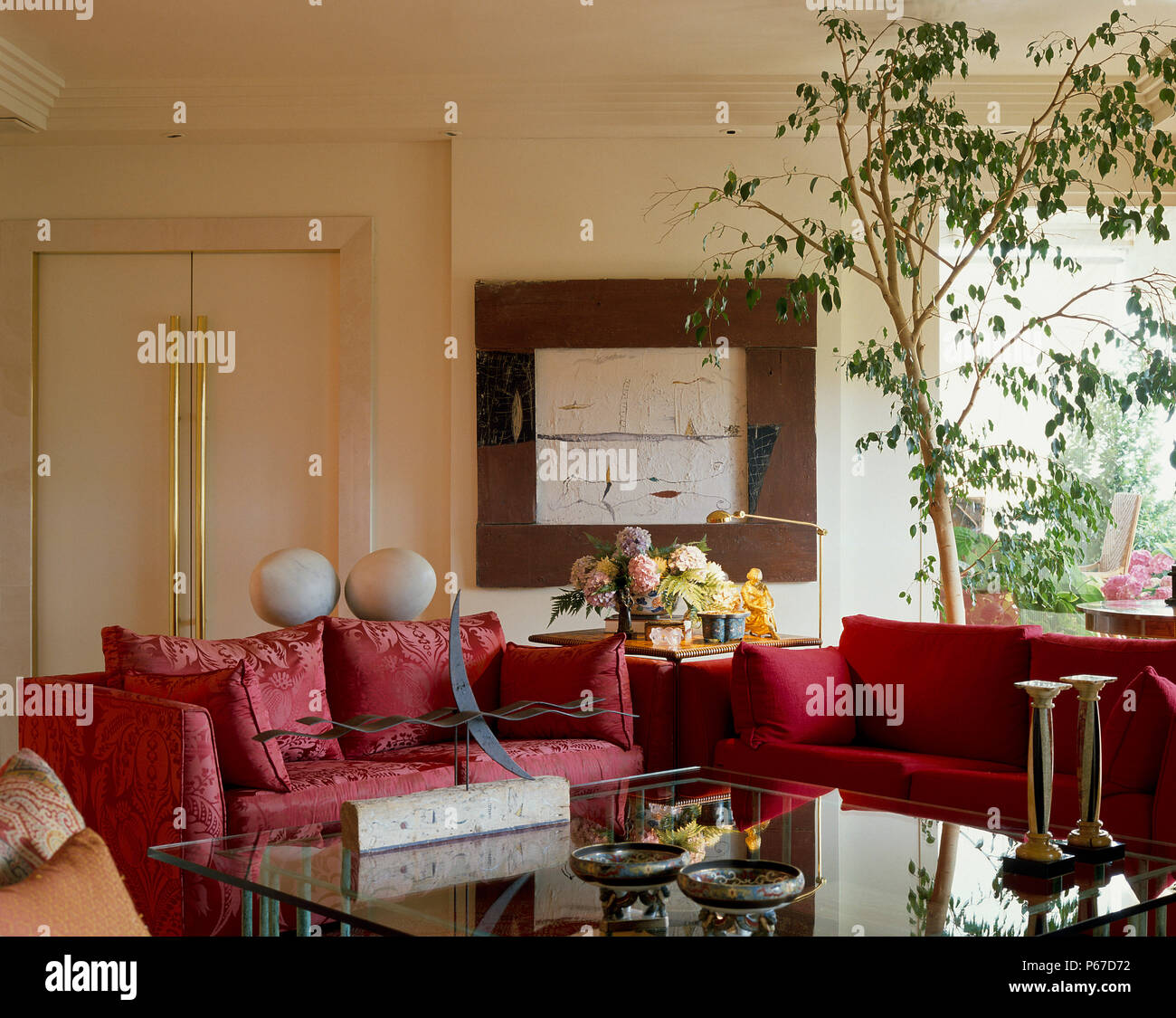 View of red couches in a living room Stock Photo: 210376406 ...