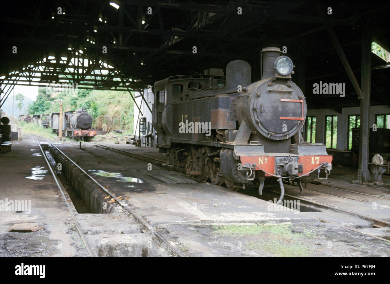 Dunkwa Loco Shed Ghana on Sunday 16th June 1985 with Hunslet 0-6-0T No.17 in the depot entrance with Vulcan Foundry built No.133 in the background. - Stock Image