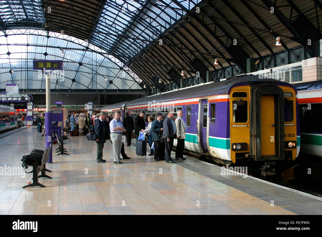 Early morning commuters join a Scotrail service at Glasgow Central station. July 2004. - Stock Image