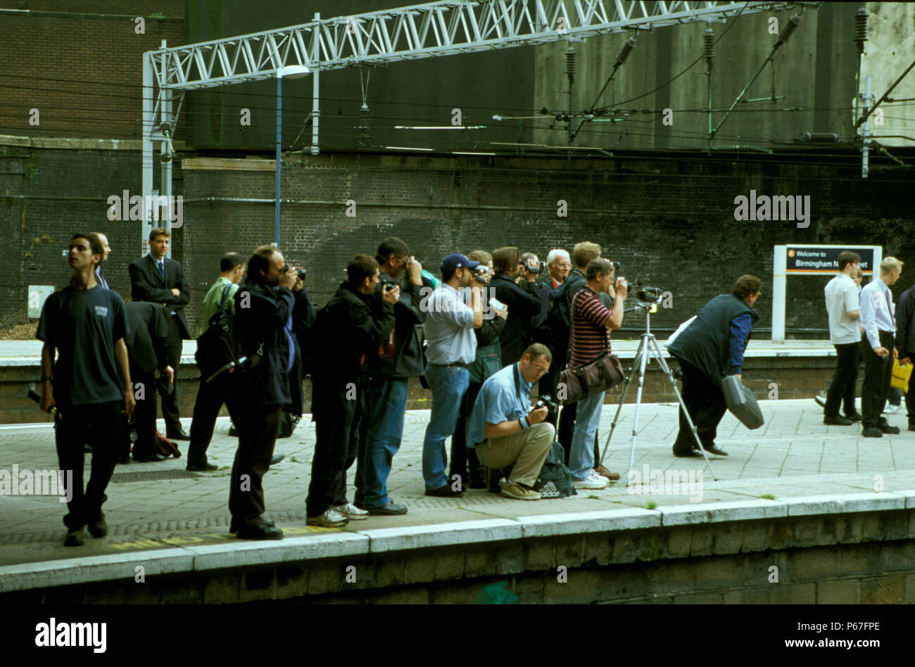 Enthusiasts and photographers at the platform end at Birmingham New Street station. 19th August 2002 - Stock Image