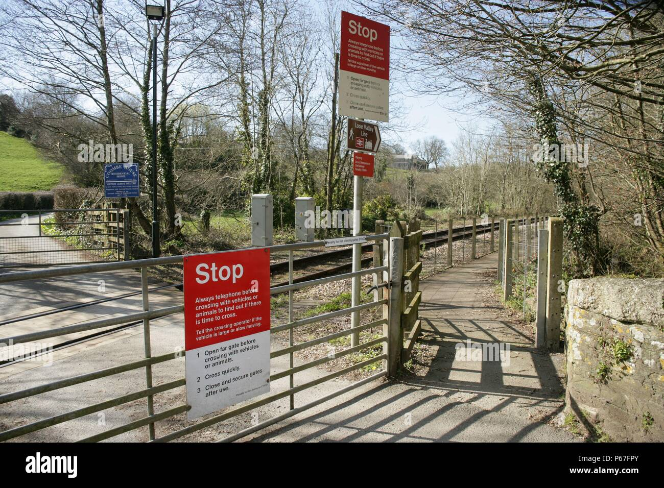Entrance to the platform and gated level crossing at Coombe station on the Liskeard to Looe branch line. 2006 - Stock Image