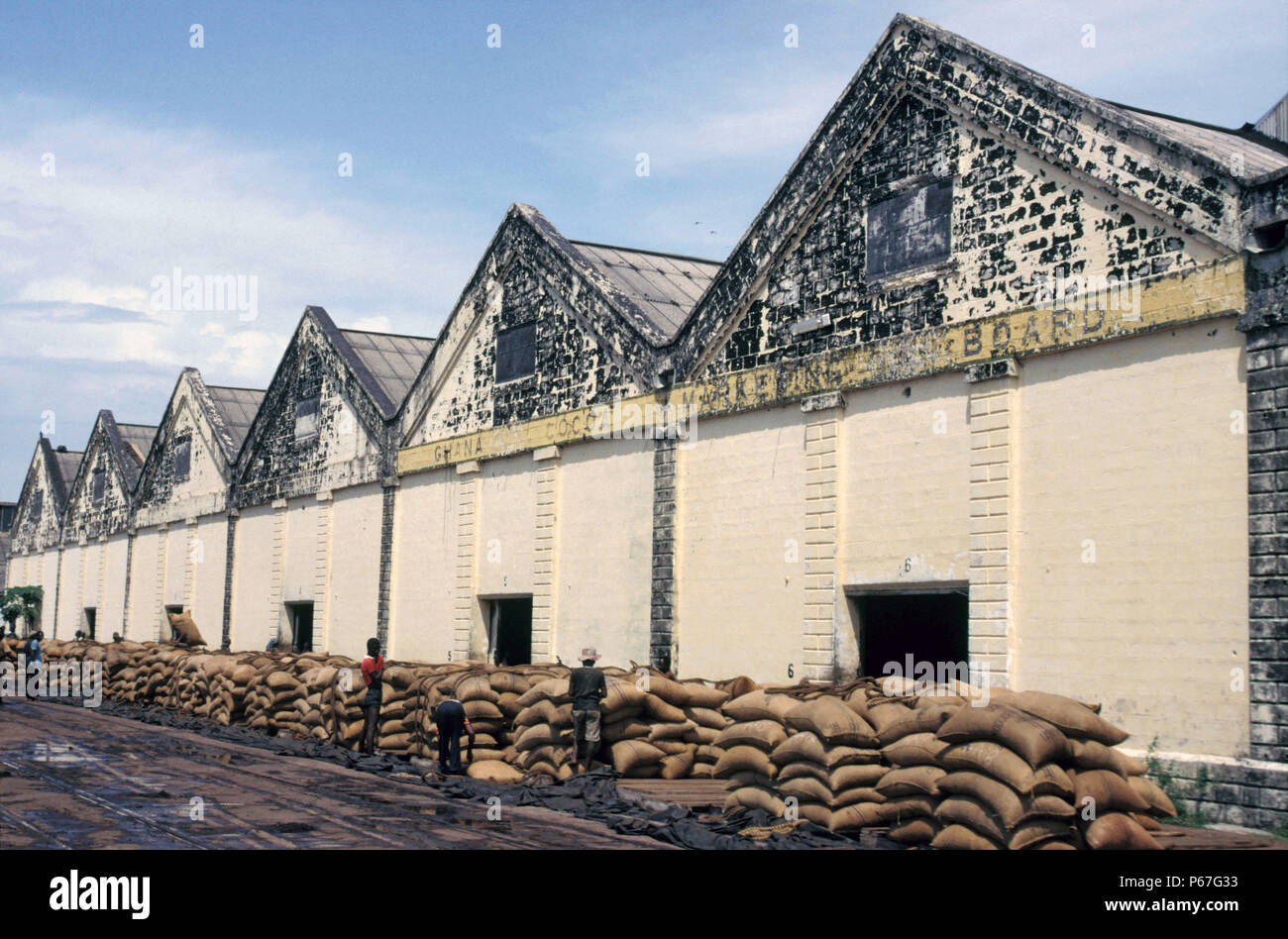 Ghana Cocoa Marketing Wharf at Takoradi on Thursday 6 June 1985. The sacks of beans which come in by rail are visible in the foreground. - Stock Image