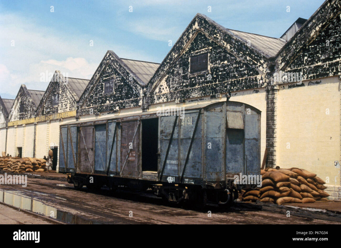 Ghana Cocoa Marketing Wharf at Takoradi on Thursday 6 June 1985. The sacks of beans which come in by rail are visible behind the box car. Thursday 6 J - Stock Image