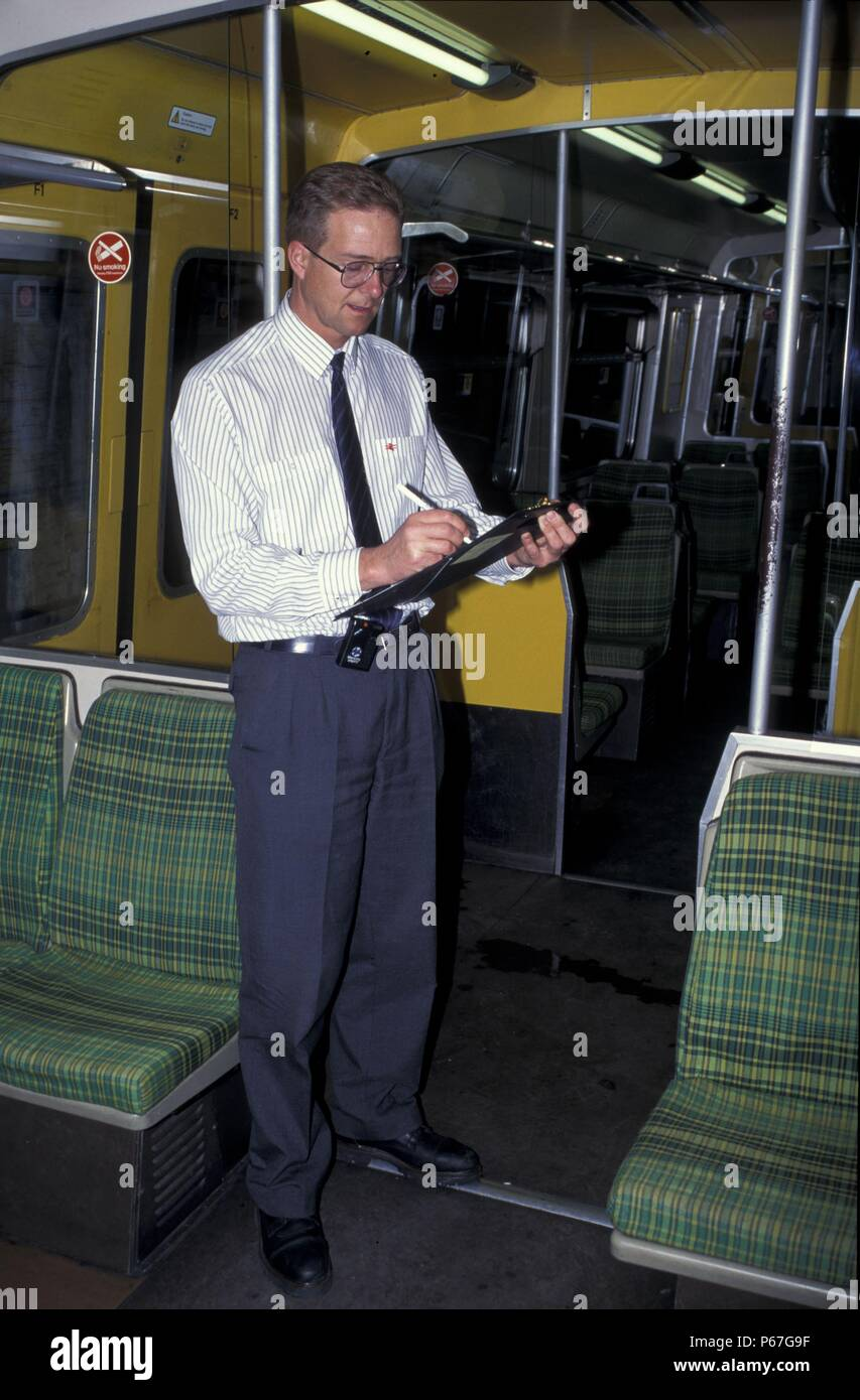 Inspecting train interior after cleaning at Birkenhead Central. May 1995 - Stock Image