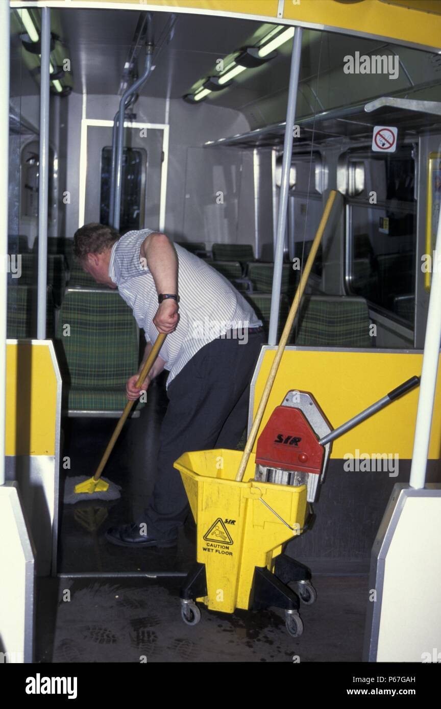 Internal train cleaning at Birkenhead Central. May 1995 - Stock Image