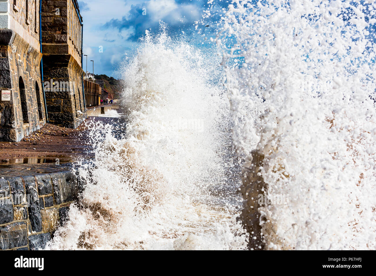 Waves crashing onto the sea wall at Dawlish in Devon, UK. - Stock Image