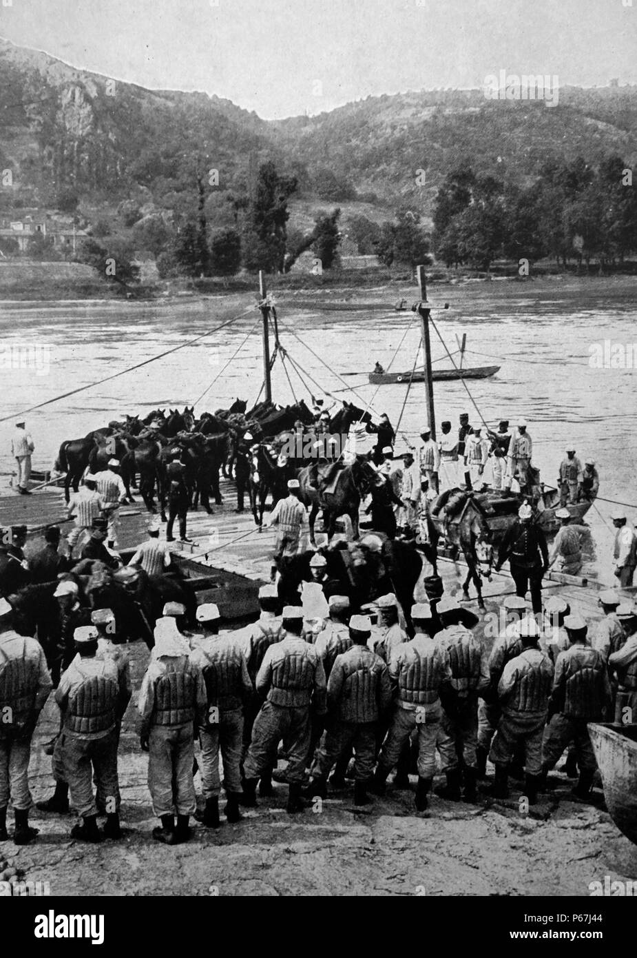 French military engineers prepare to transfer cavalry and horses across a river in northern France;   during World war one 1916. The soldiers wear life vests or jackets - Stock Image