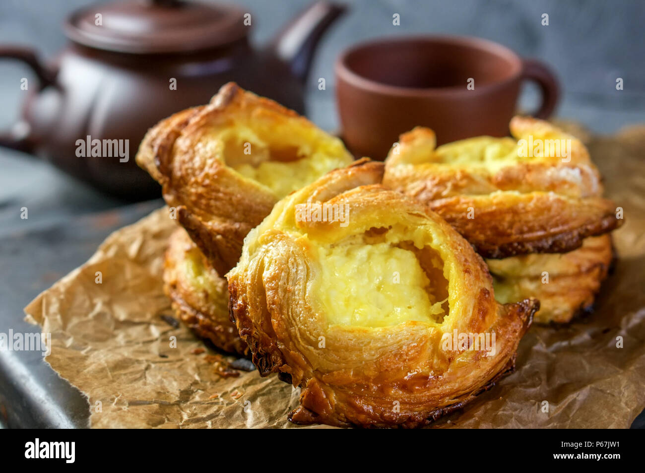 Packs puff pastry of cheese, home-European. Home making buns for tea. Stock Photo
