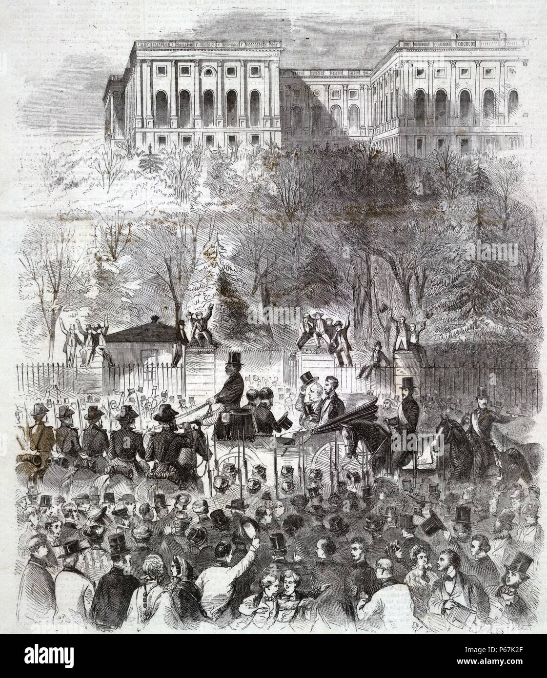The inaugural procession at Washington passing the gate of the Capitol grounds' President-elect Lincoln and President Buchanan (tipping his top hat) amidst cheering crowd before west gate at base of Capitol grounds, on their way to the Capitol for Lincoln's first inauguration. - Stock Image